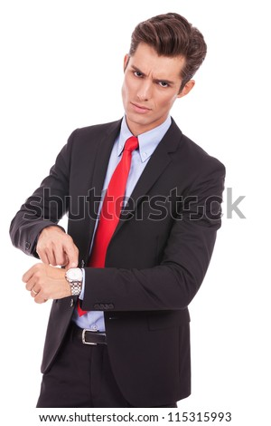 Business man impatiently pointing to his watch telling you that you are late. Isolated on white. - stock photo