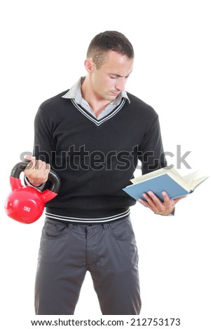business man in black sweater with shirt and pants lifting red dubell with one hand and with another one reading book - stock photo
