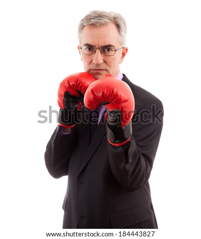 Business man in boxing gloves first punch - stock photo