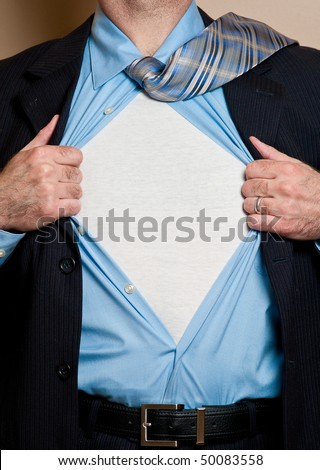 Business man in dark blue suit opens shirt to reveal blank white undershirt. Blank area suitable for your logo or text. - stock photo