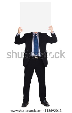 Business man in dark suit holding a blank sign, Isolated over white background - stock photo
