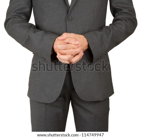 Business man in grey suit praying, isolated on white - stock photo