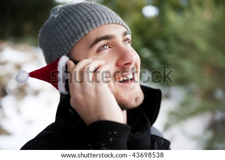 Business man in holidays talking by phone - stock photo