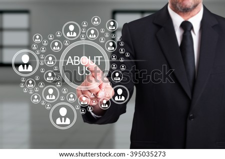 Business man in suit working with virtual networked community icon as management and social contact concept - stock photo