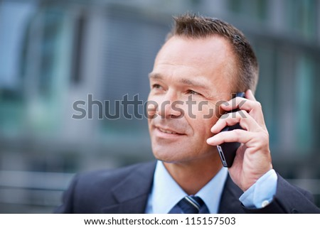 Business man in the city making a phone call with smartphone - stock photo