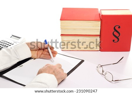 business man is working on desk with calculator - stock photo