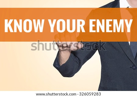 Business man Know Your Enemy word touch on virtual screen orange background - stock photo