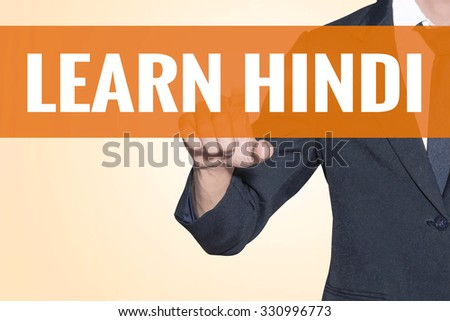 Business man Learn Hindi word touch on virtual screen orange background - stock photo
