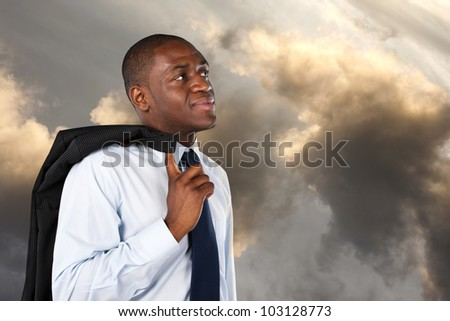 Business man looking at the sky at the end of the day - stock photo