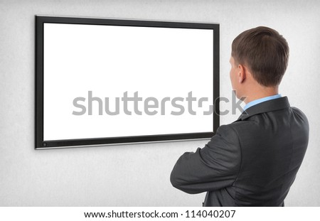 Business man looking on the empty screen - stock photo