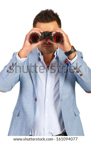 Business man looking through binocular to you isolated on white background - stock photo