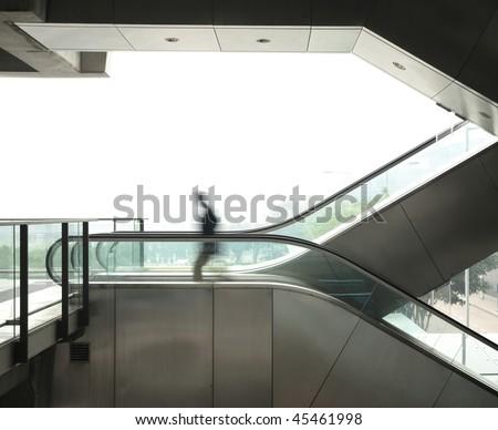 business man move on escalator - stock photo