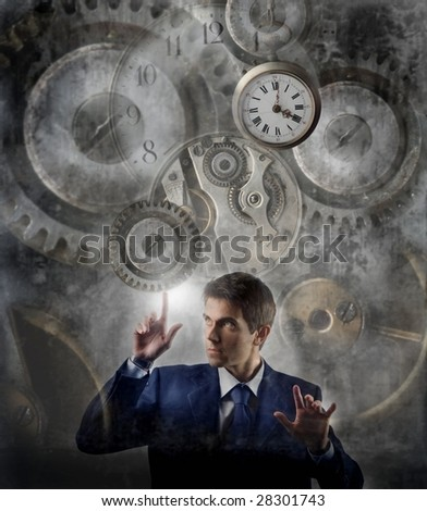 business man moving gear of big clock - stock photo