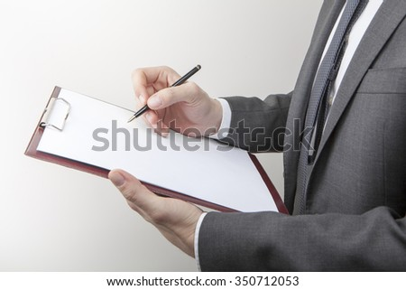 Business man note taking - stock photo