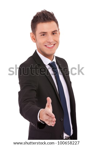 Business man offering a handshake and smiling on white background - stock photo