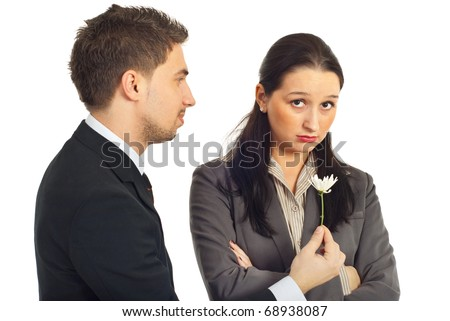 Business man offering a little flower to his sad colleague woman with the message:Fogive me that i was wrong! isolated on white background - stock photo