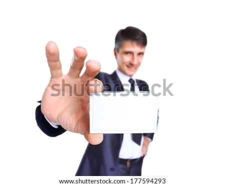 Business man offering card, isolated over white background - stock photo