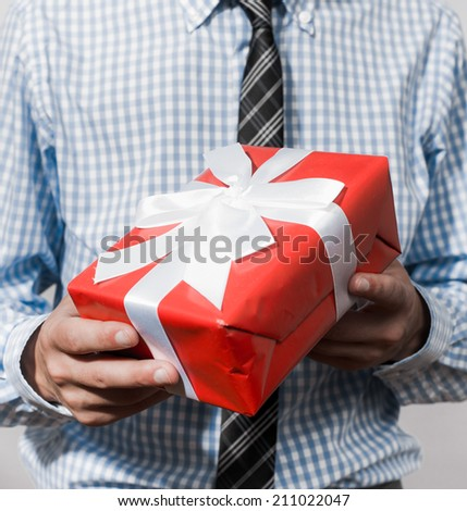 Business man offering  gift  - stock photo