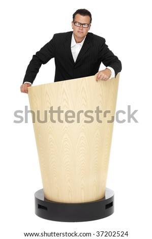 Business man on a lectern - stock photo