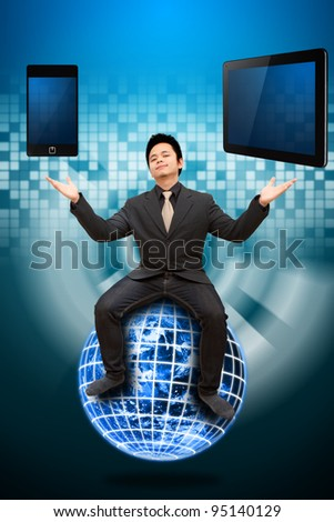 Business man on globe and select the digital device - stock photo