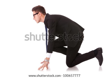 Business man on starting line of a race isolated over white background - stock photo