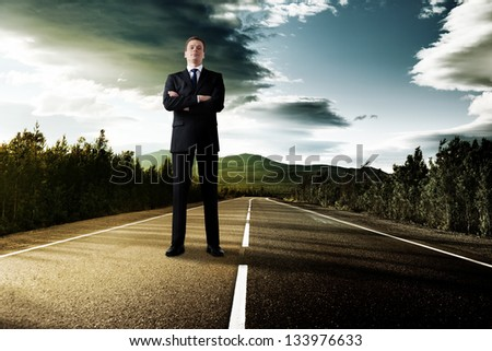 business man on the road in sunset time - stock photo