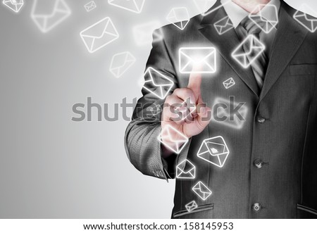 business man open email by press mail icon on touch screen - stock photo