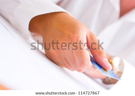 Business man paying with a credit card - stock photo