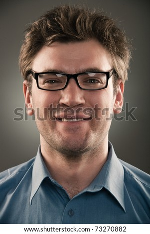 Business man person against gray background. One grunge fashion portrait  no hands of a long series images of face with different emotions.  studio light pattern - stock photo