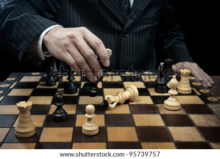 business man playing chess in dark - stock photo