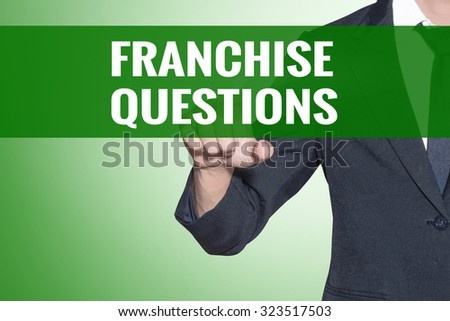 Business man point to Franchise Questions word on green tab virtual screen - stock photo