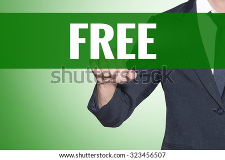 Business man point to Free word on green tab virtual screen - stock photo