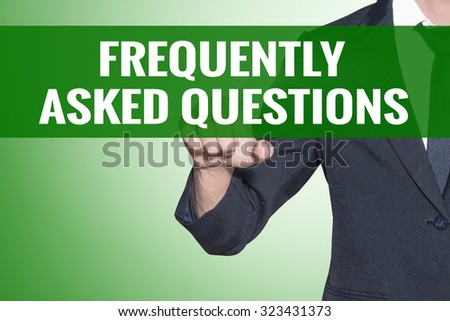 Business man point to Frequently Asked Questions word on green tab virtual screen - stock photo