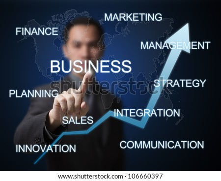 business man pointing at  business growth concept - stock photo