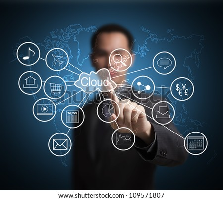 business man pointing at cloud computing and connected world wide application network - stock photo