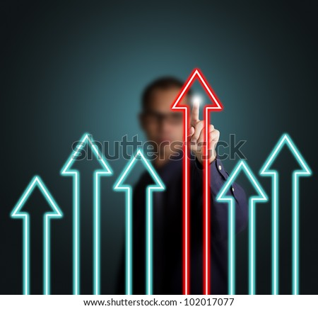 business man pointing at leading upward arrow, victory concept - stock photo