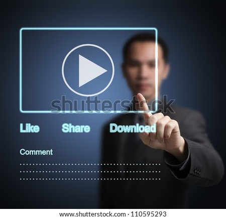 business man pointing at video clip on  social network touchscreen - stock photo