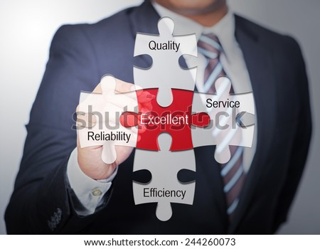 Business Man pointing on jigsaw written Excellent - stock photo