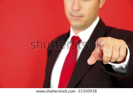Business man pointing on the red background - stock photo