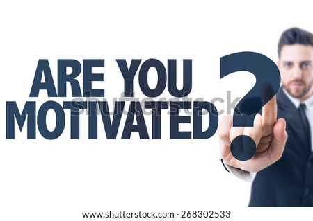 Business man pointing the text: Are You Motivated? - stock photo