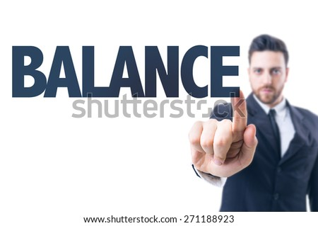 Business man pointing the text: Balance - stock photo