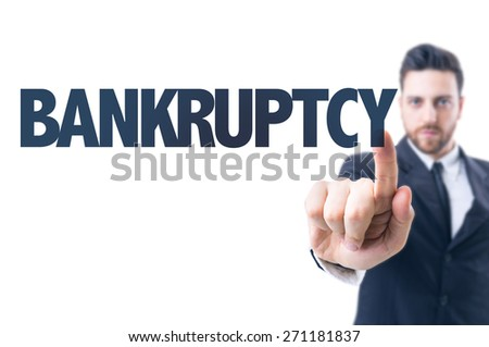 Business man pointing the text: Bankruptcy - stock photo