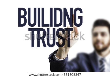 Business man pointing the text: Building Trust - stock photo