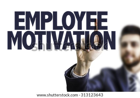 Business man pointing the text: Employee Motivation - stock photo