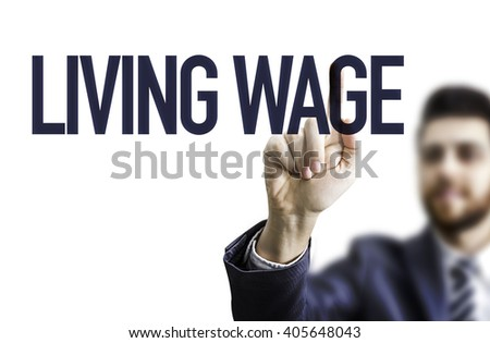 Business man pointing the text: Living Wage - stock photo