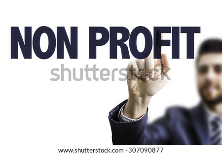 Business man pointing the text: Non Profit - stock photo
