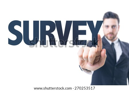 Business man pointing the text: Survey - stock photo