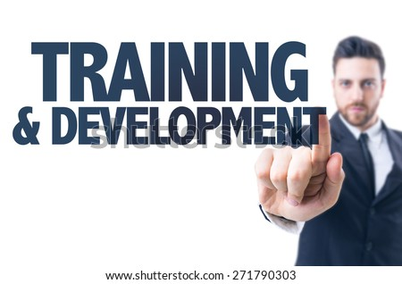 Business man pointing the text: Training & Development - stock photo
