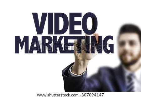 Business man pointing the text: Video Marketing - stock photo