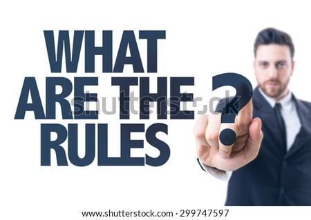 Business man pointing the text: What Are The Rules? - stock photo